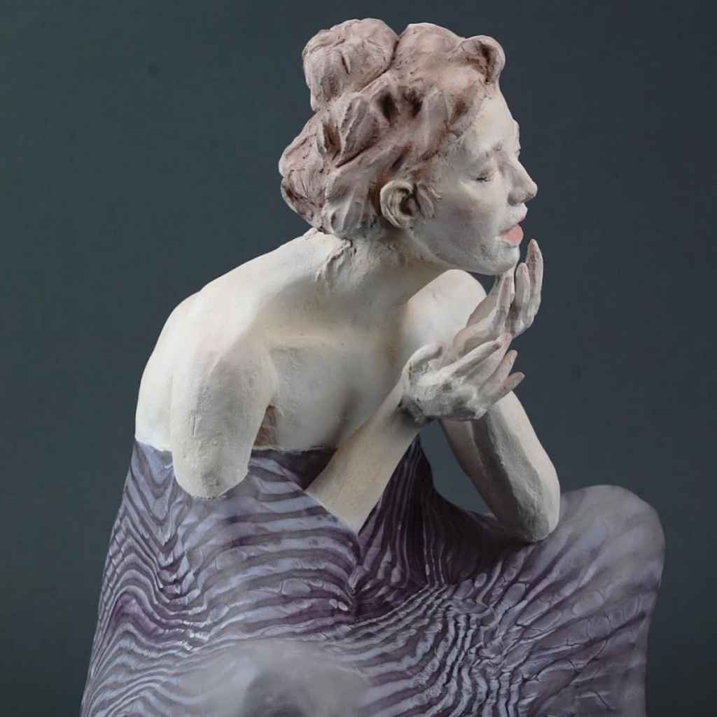 Sculpture of a woman in clay and glass- Emily Lamb