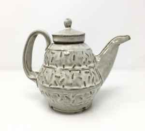 Ceramic teapot. White glaze onver tectured clay.
